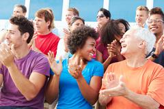 Audience Applauding At Outdoor Concert Performance - stock photo