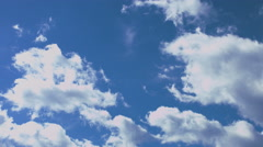 Fast moving clouds on a bright, sunny day 4k - stock footage