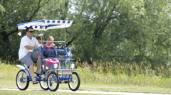 Couple riding a peddle cart having fun 6 Stock Footage
