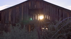Old abandoned barn with sun light streaming through open beams Stock Footage