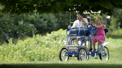Couple riding a peddle cart having fun 5 Stock Footage