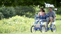 Couple riding a peddle cart having fun 3 Stock Footage