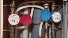 Plumber checking installed water-meters and pipes for leaks in domestic metering Stock Footage