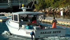 Maine lobster fishing boat heads out to sea Stock Footage