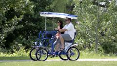 Couple riding a peddle cart having fun 2 Stock Footage