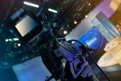 Television studio with camera and lights - recording TV show - stock photo