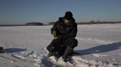 Fishing on ice Stock Footage