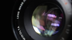 Lens aperture opening and closing with black background - stock footage