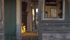 Abandoned dilapidated wood house with old furniture and broken window dolly - stock footage
