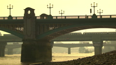 Traffic on the bridges of London, pan towards the city Stock Footage