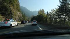 Passing accident scene. Trans Canada Highway, BC, Canada. Stock Footage