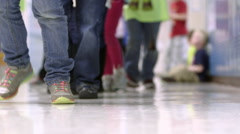 Elementary school students walking in hall of their school Stock Footage