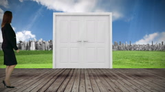 Door opening to city watched by businesswoman Stock Footage