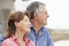 Senior couple outdoors head and shoulders - stock photo