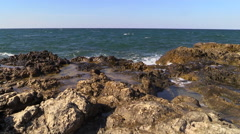 Summer Storm on the Black Sea. Waves breaking on the rocks. - stock footage