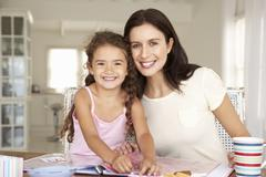 Mother and daughter scrapbooking - stock photo