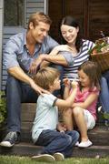 Family sitting  on veranda Stock Photos