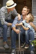 Father, son and grandson on veranda Stock Photos
