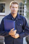 Man in overalls holding folder Stock Photos
