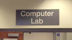 Stock Video Footage of People working in computer lab, with sign