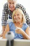 Senior couple using skype Stock Photos