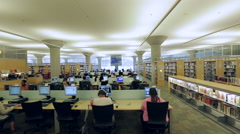 People in library using computers - stock footage