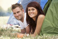 Young couple on camping trip Stock Photos