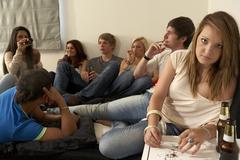 Teenagers drinking and smoking Stock Photos