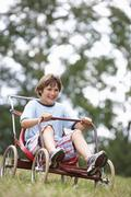 Young boy playing with go-kart Stock Photos