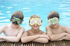 Boys in outdoor swimming pool - stock photo