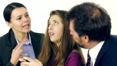 Parents fighting while teenager daughter is playing with cell phone closeup  Stock Footage