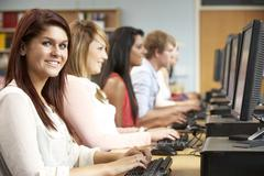 Students working on computers in library Stock Photos