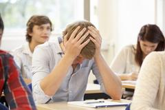 Student struggling in class Stock Photos