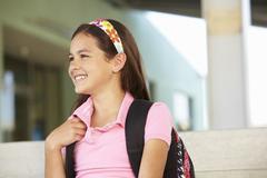 Pre teen girl at school - stock photo