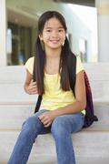 Stock Photo of Pre teen girl at school