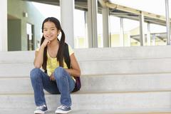 Pre teen girl at school - stock photo