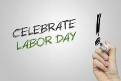 Hand writing celebrate labor day Stock Photos