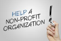 Hand writing help a nonprofit organization Stock Photos