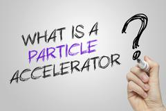 Hand writing what is a particle accelerator Stock Photos