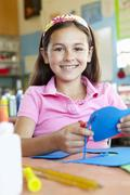 Pre teen girl in art and craft class - stock photo