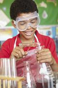 Boy in chemistry class Stock Photos