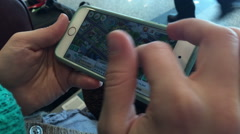 Woman Plays a Game With Her iPhone 6 Stock Footage