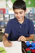 Boy in physics class - stock photo