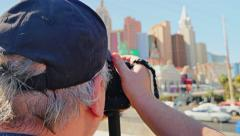 Man Takes Picture of Las Vegas Strip Stock Footage