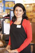 Supermarket checkout worker - stock photo