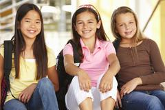 Pre teen girls in school - stock photo