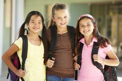 Pre teen girls at school - stock photo