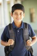 Stock Photo of Pre teen boy at school