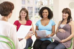 Pregnant women at ante natal class - stock photo
