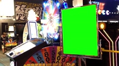 Green billboard for your ad beside video game - stock footage
